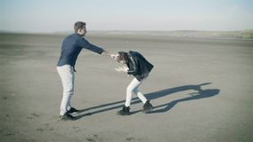 Brother and young sister imitation fight, fool around outdoors. Hand puts on his head, embraces stock footage