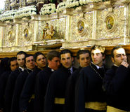 Brotherhood Carrying Throne. A brotherhood carrying a gold throne during the Good Friday Ceremony during Holy Week, Malaga, Spain Stock Images