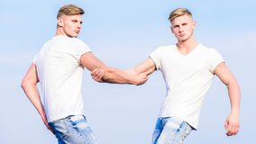 Brotherhood concept. Benefits of having twin brother. Benefits and drawbacks of having identical twin brother. Friendship and support. Men muscular twins stock photos