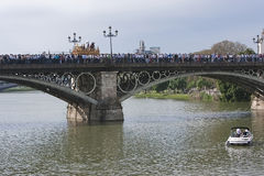 Brotherhood of San Gonzalo passing the holy Monday by the Puente de Triana Royalty Free Stock Photography