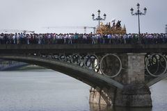 Brotherhood of San Gonzalo passing the holy Monday by the Puente de Triana Stock Photo