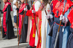 Brotherhoods marching in a catholic procession Stock Image