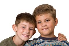 Brotherly Love 2. Big and little brother sitting smiling isolated on a white background Royalty Free Stock Photo