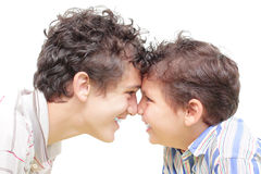Brothers. Face to face or kiss Eskimo Royalty Free Stock Photography