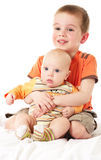 Brothers. Big brother embraceing his little brother stock image