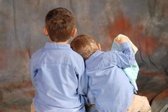 Brothers. Two brothers portrait with their backs to the camera Royalty Free Stock Images