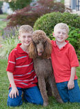 Brothers. With Their Standard Poodle Stock Photo