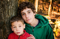 Brothers. Two brothers outdoors in a forest Royalty Free Stock Images