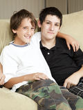 Brothers. Portrait of brothers - a teenage boy with acne and a younger boy royalty free stock photo