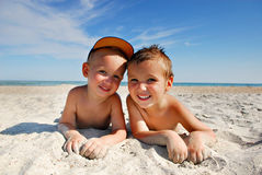 Brothers. Two brothers  Lying  on the sea beach under the summer sun Stock Image