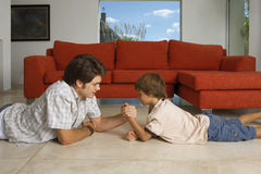 Brothers arm wrestling. Stock Photos
