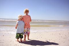 Brothers on Beach Looking at Ocean Royalty Free Stock Photography