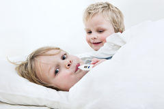 Brothers in bed Royalty Free Stock Photos