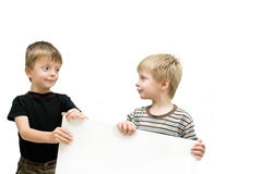 Brothers with blank sign Stock Photo