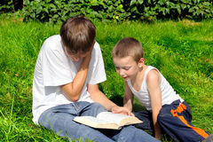 Brothers with book Royalty Free Stock Photos