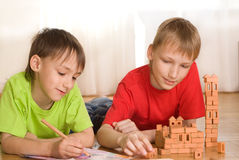 Brothers are building  of a toy castle Royalty Free Stock Images