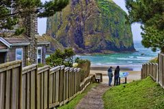 Brothers at Cannon Beach on Oregon Coast. Two brothers at the end of a public beach access path where one can either venture onto the beach at Cannon Beach stock photo