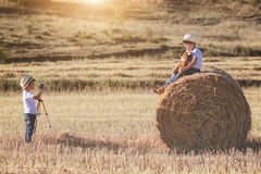 Brothers. Children playing in the field Royalty Free Stock Photography