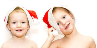 Brothers in Christmas hats Royalty Free Stock Photos