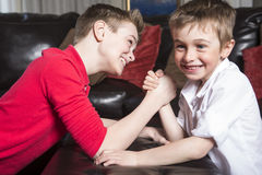 Brothers compete in arm wrestling Stock Photography