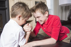 Brothers compete in arm wrestling Royalty Free Stock Images