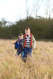 Brothers in a country field in the winter Royalty Free Stock Photo