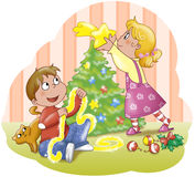 Brothers Decorating A Tree Royalty Free Stock Image