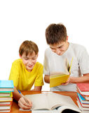Brothers doing Homework. Brothers with the Books doing Homework on the White Background Royalty Free Stock Photo