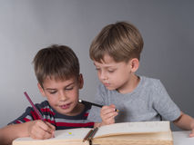 Brothers drawing togther Stock Photo