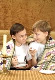 Brothers drink tea at home Stock Photos
