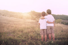 Brothers. Embraced watching the sun Royalty Free Stock Photos