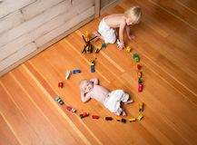 Brothers Encircled by a Heart Made from Wooden Trains and Vehicles. royalty free stock photo