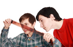 Brothers examine negatives Stock Image