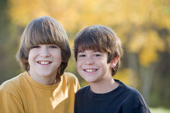 Brothers in the Fall. Brothers Smiling Big in the Fall Colors Stock Photos