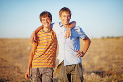 Brothers in a field Royalty Free Stock Photo