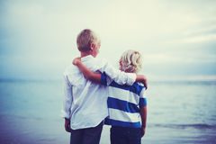 Brothers, Friendship Concept. Brothers, Happy young brothers hugging at sunset. Friendship brotherhood concept Royalty Free Stock Photo