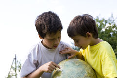 Brothers and globe Stock Images