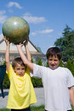 Brothers and globe Stock Image
