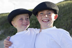Brothers with hats smiling outside Stock Photos