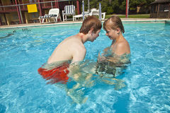 Brothers have fun in the pool Stock Images