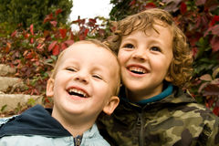 Brothers having fun. Cute brothers having fun during autumnal walk Stock Photo