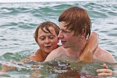 Brothers Having Fun In The Ocean Stock Images