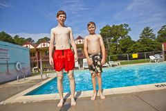 Brothers having fun at the pool Stock Image