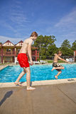 Brothers having fun at the pool. Two brothers having fun at the pool Stock Photography