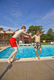 Brothers having fun at the pool. Two brothers having fun at the pool Royalty Free Stock Photo