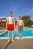 Brothers having fun at the pool Royalty Free Stock Photos