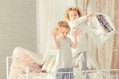 Brothers having pillow fight. And making mess in bedroom royalty free stock photography
