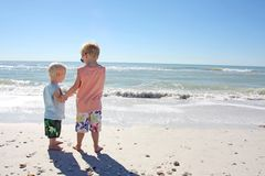 Brothers Holding Hands on the Beach Royalty Free Stock Image