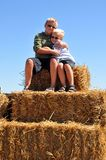 Brothers Hug. On Top of Straw Bales on Farm Stock Photography