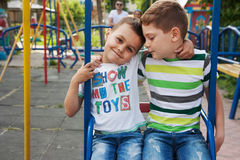 Brothers hug on playground Stock Photography